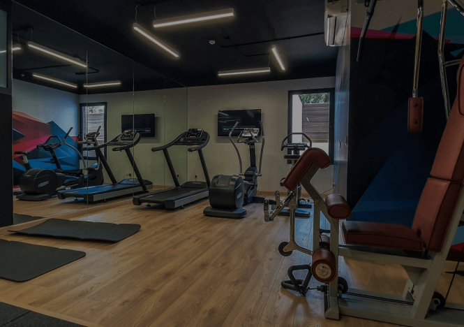 <p>Guests can maintain their wellness routines at the on-site fitness center located on the ground floor, which is fitted with Technogym equipment including treadmills, stationary bikes, free weights, and a multi-gym machine offering a comprehensive range of training equipment.</p>